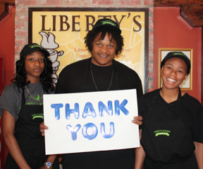 Liberty's Kitchen students holding Thank You sign